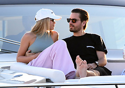 Scott Disick wraps his arms around girlfriend Sofia Richie as they watch the sunset from a yacht in Miami. 25 Nov 2019 Pictured: Sofia Richie; Scott Disick. Photo credit: MEGA TheMegaAgency.com +1 888 505 6342