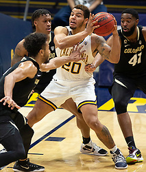 Feb 13, 2021; Berkeley, California, USA; California Golden Bears guard Matt Bradley (20) is surrounded by a trio of Colorado Buffaloes defenders during the second half of an NCAA basketball game at Haas Pavilion. Mandatory Credit: D. Ross Cameron-USA TODAY Sports