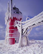 Icicles coating the South Haven Pier Lighthouse following a severe winter storm at the mouth of the Black River into Lake Michigan, January 10, 2015, South Haven, Michigan.