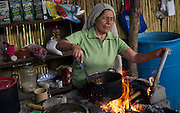 In this July 26, 2016 photo, newlywed Francisca Santiago, 65, stokes the fire while preparing hot chocolate in her Santa Ana home, in the Mexican state of Oaxaca. Santiago first met her husband, at the age of 16, in 1967 while tending goats in the fields outside of Santa Ana, and a few years later they were married in a civil ceremony. But until Pope Francis' reforms to the church's annulment process went into effect on Dec. 8, 2015, she didn't think she would ever be married to her husband, a divorcee, in a religious ceremony. NICK WAGNER / ASSOCIATED PRESS