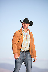 cowboy walking outdoors