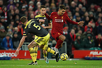 Football - 2019 / 2020 Premier League - Liverpool vs. Southampton<br /> <br /> Liverpool's Roberto Firmino is tackled by Southampton's Jack Stephens<br /> <br /> Colorsport / Terry Donnelly