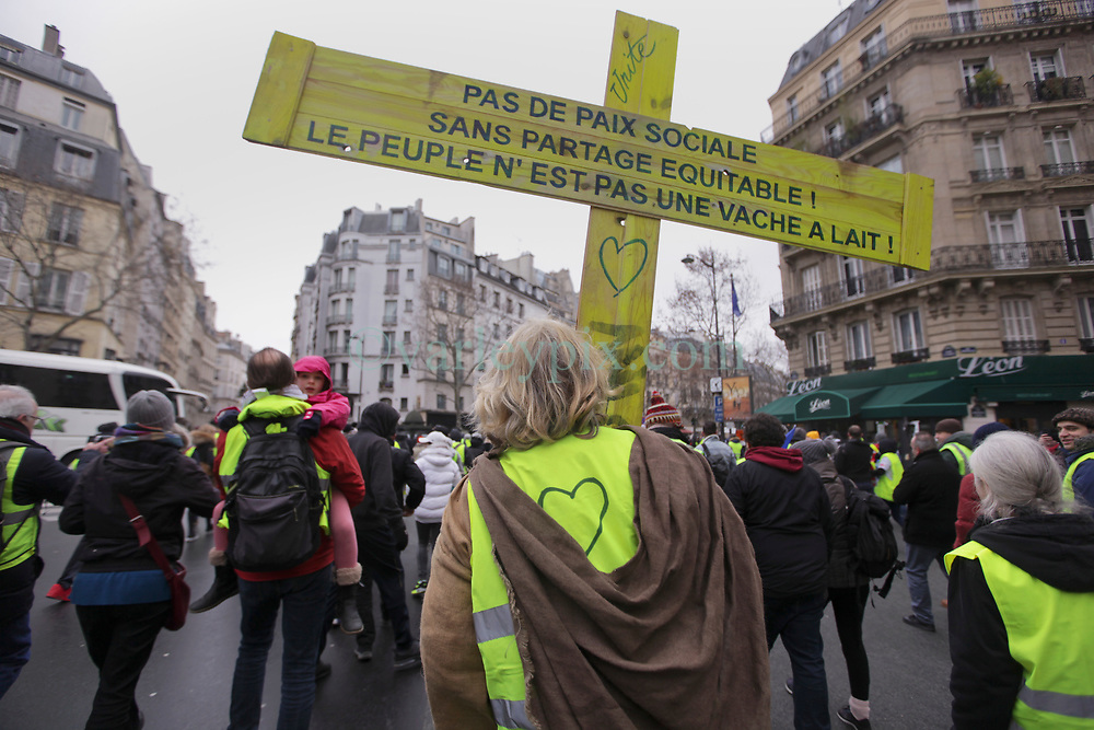19 January 2019. Paris, France.<br /> Gilets Jaunes - Acte X take to the streets of Paris. 'Jesus' joins the march. An estimated 7,000 people took part in the looping 14 km route from Place des Invalides to protest tax hikes from the Government of Emmanuel Macron imposed on the people. An estimated 80,000 people took part in protests across the country. Regrettably the movement has attracted a violent element of agitators who often face off with riot police at the end of the marches which tends to deflect attention away from the message of the vast majority of peaceful protesters.<br /> Photo©; Charlie Varley/varleypix.com