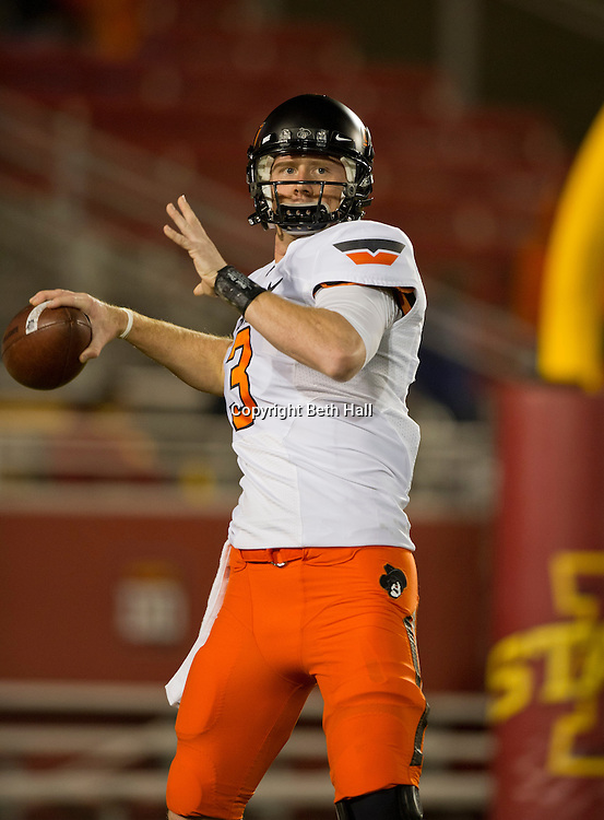 Nov 18, 2011; Ames, IA, USA; Oklahoma State Cowboys quarterback Brandon Weeden (3) looks to make a pass before the start of a game against the Iowa State Cyclones at Jack Trice Stadium. Iowa State Cyclones defeated the Oklahoma State Cowboys 37-31. Mandatory Credit: Beth Hall-US PRESSWIRE Editorial sports photography of the Iowa State Cyclones vs. Oklahoma State Cowboys in 2011 in Aimes, Iowa.