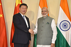 October 15, 2016 - Goa, India - Indian Prime Minister Narendra Modi welcomes Chinese President Xi Jinping for a bilateral meeting before the BRICS Summit at the Taj Exotica Hotel October 15, 2016 in Goa, India. (Credit Image: © Lalit Kumar/Planet Pix via ZUMA Wire)