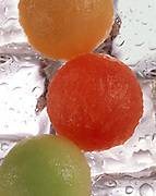 3 scoops of different varieties of melon on ice