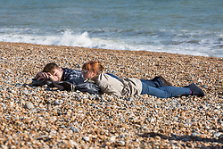 © Licensed to London News Pictures. 31/03/2017. Brighton, UK. Members of the public enjoy the sunny and warm weather by spending time on the beach and promenade in Brighton. Photo credit: Hugo Michiels/LNP