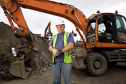 Olympic Park. Two large remediation plants have been created on the Olympic Park with soil washing machines installed to wash, sieve and shake out the contamination.<br />  <br /> Contamination of the area has built up through a century of neglect and heavy industrial use, making this one of the UK's most challenging land clean-up jobs. Picture shows driver Sean Leonard. Picture taken on 03 Jun 09 by Dave Poultney. <br /> <br /> **model released**