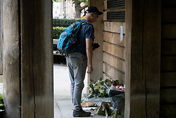 © Licensed to London News Pictures. 11/09/2021. London, UK. A member of the public looks at a memorial in Grosvenor Square in London on the 20th anniversary of the 9/11 terrorist attack. The attacks, which killed a total of 2,977 people, saw passenger jets seized by suicide attackers, flown into the Twin Towers of the World Trade Center in New York and the The Pentagon building. Photo credit: Ben Cawthra/LNP