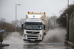© Licensed to London News Pictures. 26/01/2014. M3, Basingstoke, Hampshire, UK. A lorry driving through flood water en-route to a Sainsbury's Distribution Depot in Basingstoke today (26/01/2014). Wet and windy weather has engulfed much of the UK over the weekend. Photo credit : Rob Arnold/LNP