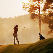 A man playing golf in the UK
