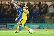 Ryan McLaughlin is challenged during the EFL Sky Bet League 1 match between Rochdale and Oxford United at Spotland, Rochdale, England on 12 March 2019.