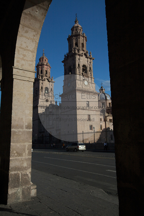 Morelia Cathedral on the Plaza de Armas Morelia, Michoacan state Mexico. The city is a UNESCO World Heritage Site and hosts on of the best preserved collection of Spanish Colonial architecture in the world. Commissioned by the Duke of Albuquerque, appointed Viceroy to the territories of Mexico, ordered its construction in 1660 which was carried out by the Italian master Vicente Barroso until his death in 1692 it took an additional 52 years to complete. The Cathedral has the highest and bulkiest church towers of the continent.