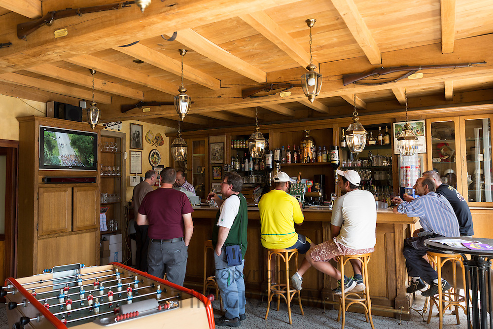 Locals in a bar watch the Tour de France bike race on the Champagne Tourist Route at Mancy, the Marne, Champagne-Ardenne, France