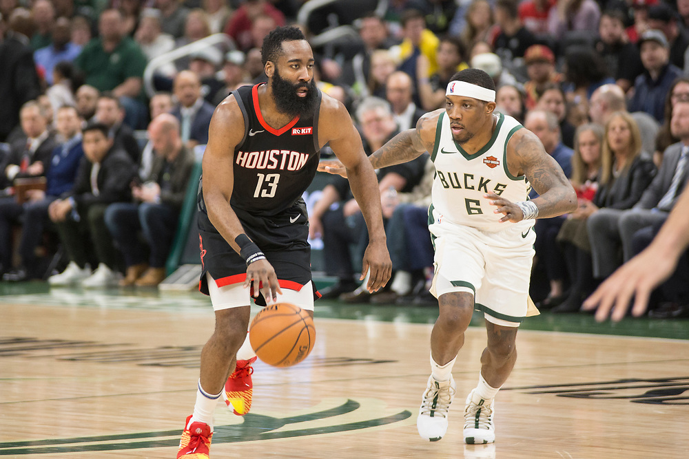 James Harden driving past Eric Bledsoe during the Milwaukee Bucks' game against the Houston Rockets on March 26, 2019.