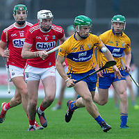 Clare's Gary Cooney gets away from Cork's Tim O'Mahony