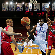 Anadolu Efes's Stephane Lasme (2ndR) and Ted Kolej's Alade Aminu (R) during their Turkish Basketball League match Anadolu Efes between Ted Kolej at Abdi Ipekci Arena in Istanbul Turkey on Monday 16 March 2015. Photo by Aykut AKICI/TURKPIX