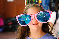 Girl wearing over sized  sun glasses