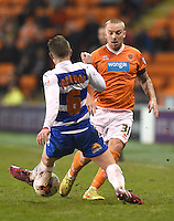 Blackpool's Jamie O'Hara slips the ball through the feet of Reading's Oliver Norwood<br /> <br /> Photographer Dave Howarth/CameraSport<br /> <br /> Football - The Football League Sky Bet Championship - Blackpool v Reading - Tuesday 7th April 2015 - Bloomfield Road - Blackpool<br /> <br /> © CameraSport - 43 Linden Ave. Countesthorpe. Leicester. England. LE8 5PG - Tel: +44 (0) 116 277 4147 - admin@camerasport.com - www.camerasport.com