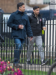 © Licensed to London News Pictures. 03/04/2021. London, UK. Chancellor of the Exchequer RISHI SUNAK (right) is seen relaxing in near Downing Street in Westminster. On April 12th England is set to relax more lockdown restrictions which were imposed to control the spread of COVID-19. Photo credit: Ben Cawthra/LNP