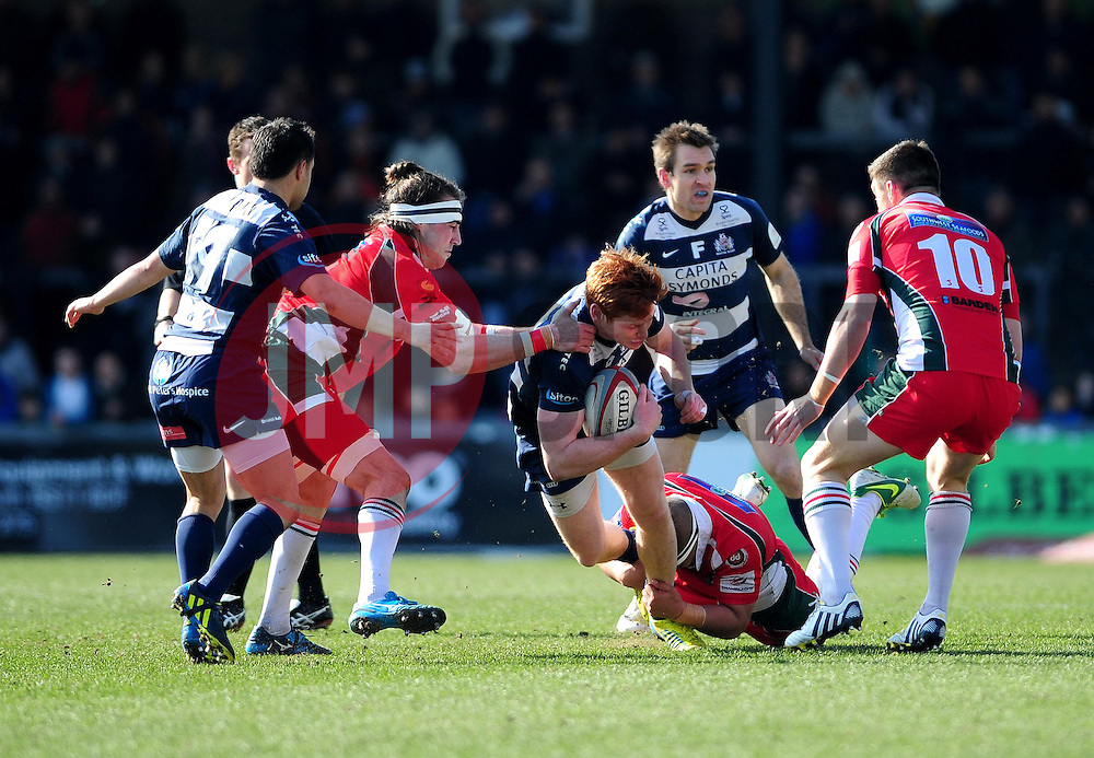 Bristol Winger (#14) Jack Tovey is tackled from behind by Plymouth Albion Flanker (#7) Sam Matavesi - Photo mandatory by-line: Dougie Allward/JMP - Tel: Mobile: 07966 386802 31/03/2013 - SPORT - RUGBY - Memorial Stadium - Bristol. Bristol v Plymouth Albion - RFU Championship.