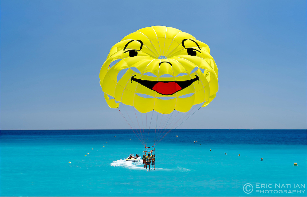 Smiley-faced parasail in the Baie des Anges (Bay of Angels) in Nice on the Meditteranean coast in southern France.
