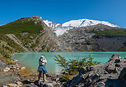 A short, steep, attractive hike leads to Huemul Lake and Glacier (4 km round trip with 215 m gain) on private land. Pay the trail entrance fee at the campground at Estancia Lago Del Desierto. Directions: drive north from El Chalten for 35 km on gravel road RP23, leaving the national park, to reach Punta Sur of Lago del Desierto, in Santa Cruz Province, Argentina, Patagonia, South America. This image was stitched from multiple overlapping photos.