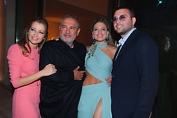L-R : Claudine Saab, Elie Saab, Christina Mourad and Elie Saab Jr seen at Elie Saab Jr (Fashion designer Elie Saab's son) and Christina Mourad wedding post party dinner, in Faqra, Lebanon on July 20, 2019. The wedding is among the most incredible weddings of 2019, included four wedding outfits, over a million sequins and 1,200 guest. Photo by Balkis Press/ABACAPRESS.COM
