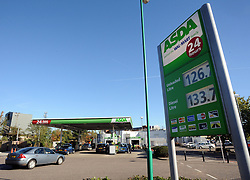 © Licensed to London News Pictures. 30/10/2013<br /> Asda cuts cost of petrol.<br /> This Asda petrol station in Greenhithe,Kent near Dartford has cut the price of Unleaded down to 126.7p.<br /> ASDA is the first big British supermarket to cut petrol prices TODAY (30.10.2013)<br /> Photo credit :Grant Falvey/LNP