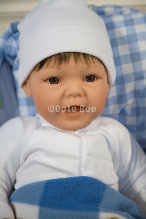 face of a smiling caucasian baby doll