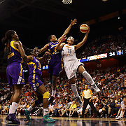Alyssa Thomas, (right), Connecticut Sun, is rejected by Alana Beard, Los Angeles Sparks, during the Connecticut Sun Vs Los Angeles Sparks WNBA regular season game at Mohegan Sun Arena, Uncasville, Connecticut, USA. 3rd July 2014. Photo Tim Clayton