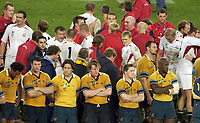 Photo. Steve Holland. England v Australia Final at the Telstra Stadium, Sydney. RWC 2003.<br />22/11/2003.<br />Australian team look dejected with England in background  after winning the World Cup