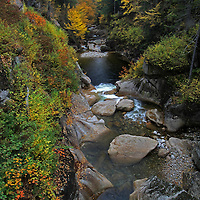 Outdoor landscape photography images of this beautiful autumn scenery at Liberty Gorge from the Franconia Notch State Park of the White Mountains in New Hampshire are available as museum quality photography prints, canvas prints, acrylic prints or metal prints. Prints may be framed and matted to the individual liking and decorating needs:<br /> <br /> http://juergen-roth.artistwebsites.com/featured/liberty-gorge-juergen-roth.html<br /> <br /> Peak New England fall foliage colors at the scenic Liberty Gorge of Franconia Notch State Park near Lincoln, NH. The beautiful cascading mountain stream flows through this narrow valley into The Pool. The pool is a deep basin in the Pemigewasset River and was formed at the end of the iceage.<br /> <br /> Good light and happy photo making!<br /> <br /> Good light and happy photo making! <br /> <br /> Juergen <br /> Prints: www.RothGalleries.com <br /> Licensing: www.ExploringTheLight.com <br /> Photo Blog: http://whereintheworldisjuergen.blogspot.com <br /> @NatureFineArt
