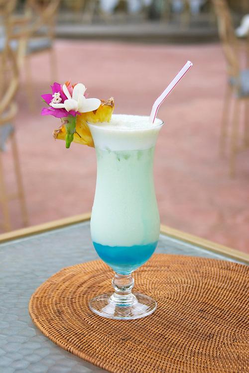 Tropical blue cocktail on straw mat, Bora Bora, Society Islands