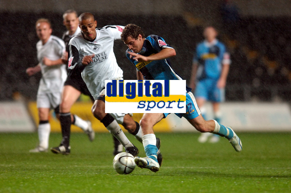 Photo: Adam Davies.<br />Swansea City v Wycombe Wanderers. Carling Cup. <br />22/08/2006.<br />Wycombe's Sergio Torres and Swansea's Darren Pratley (L).