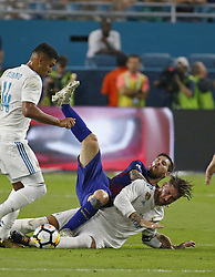 Real Madrid defender Sergio Ramos, bottom right, battles for the battles for the ball against Barcelona forward Lionel Messi during the first half in International Champions Cup action on Saturday, July 29, 2017, at Hard Rock Stadium in Miami Gardens, FL, USA. Photo by David Santiago/El Nuevo Herald/TNS/ABACAPRESS.COM