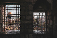 View through a window in Jerusalem's Muslim Quarter of the Dome of the Rock.