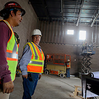 Field foreman Beau Dean, left, talks with project manager Steve Schmaltz at the new Ramah Elementary School construction site in Ramah Wednesday.