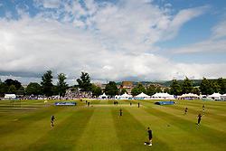The rain covers are removed before the start of the T20 game between Gloucestershire Cricket and Kent Cricket - Photo mandatory by-line: Dougie Allward/JMP - Mobile: 07966 386802 - 12/07/2015 - SPORT - Cricket - Cheltenham - Cheltenham College - Natwest Blast T20
