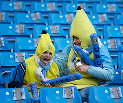 MANCHESTER, ENGLAND - Monday, April 30, 2012: Two Manchester City supporters dressed as bananas during the Premiership match against Manchester United at the City of Manchester Stadium. (Pic by David Rawcliffe/Propaganda)