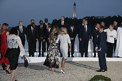 G7 leaders and guests pose for a family picture on the second day of the annual G7 summit in Biarritz, France, August 25, 2019. (First row) LtoR Britain's Prime Minister Boris Johnson, South Africa's President Cyril Ramaphosa, Rwanda's President Paul Kagame, African Union Chair Egyptian President Abdel Fattah el-Sisi, Japanese Prime Minister's wife Akie Abe, Japan's Prime Minister Shinzo Abe, Canada's Prime Minister Justin Trudeau,US First Lady Melania Trump, US President Donald Trump, French President's wife Brigitte Macron, France's President Emmanuel Macron, Germany's Chancellor Angela Merkel, Senegal's President Macky Sall, Burkina Faso's President Roch Marc Christian Kabore, Chile's President Sebastian Pinera, his wife Cecilia Morel, Italy's Prime Minister Giuseppe Conte, EU Council President's wife Malgorzata Tusk, European Council President Donald Tusk. (Second row) Chile's President Sebastian Pinera (L), Chairperson of the African Union Commission Moussa Faki Mahamat (2ndL), Australian Prime Minister Scott Morrison (5thL) his wife Jenny Morrison, United Nations Secretary-General Antonio Guterres (7thR), India's Prime Minister Narendra Modi (6thR), Spain's Prime Minister Pedro Sanchez (4thR), Spanish Prime Minister's wife Begona Sanchez (3rdR), OECD Secretary-General Jose Angel Gurria (2ndR), African Development Bank president Akinwumi Adesina (R)in Biarritz, France, 25 August 2019, on the G7 summit. The G7 Summit runs from 24 to 26 August in Biarritz. Photo Patrick Aventurier/ABACAPRESS.COM