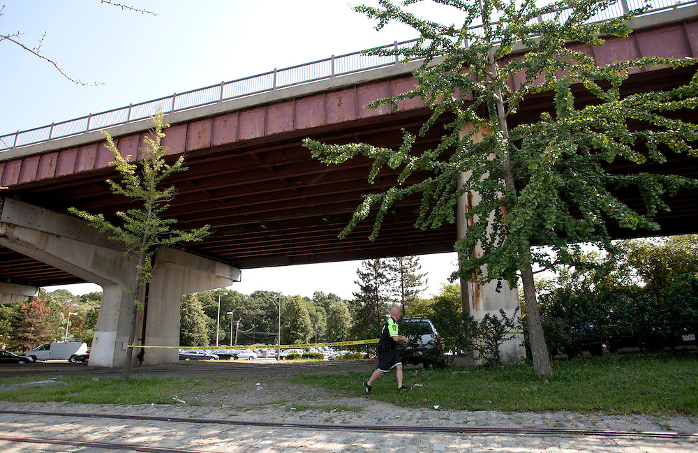 Boston, MA 08/31/2012<br /> A Boston Police officer stretches police line tape in front of the Casey Overpass on Friday afternoon after reports of debris falling from the structure.<br /> Alex Jones / www.alexjonesphoto.com
