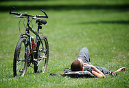 A cyclist takes a break on the grounds of the National Mall in Washington D.C.
