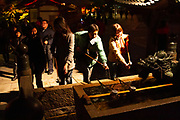 Visitors cleanse themselves at a Temple at night, Kyoto, Japan