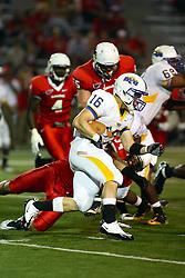 10 September 2011: Brandon Bomhauser works his way to the right gets caught by Josh Howe during an NCAA football game between the Morehead State Eagles and the Illinois State Redbirds at Hancock Stadium in Normal Illinois.