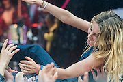 Wolf Alice play the Park Stage and the lead singer goes crowd surfing in the rain. The 2015 Glastonbury Festival, Worthy Farm, Glastonbury.