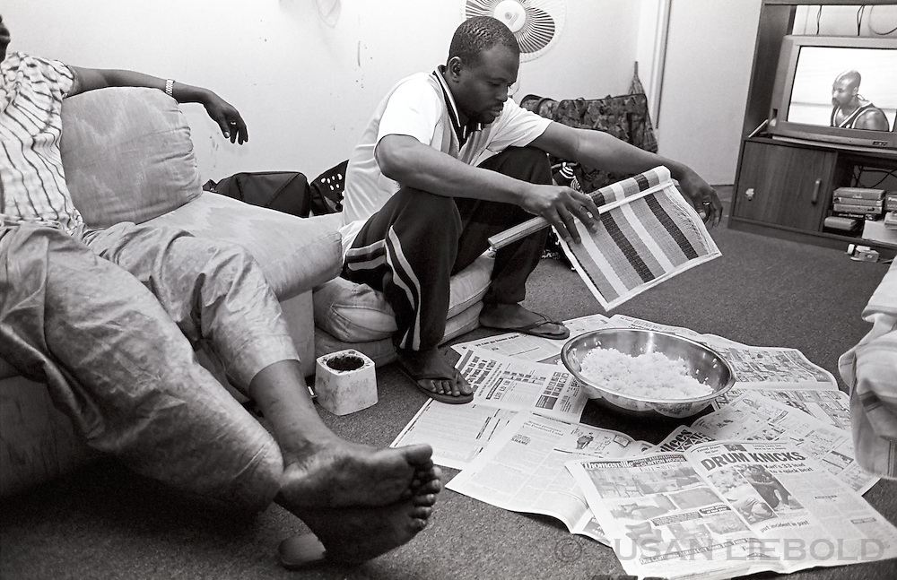 Cooling the bowl of rice for dinner, Harlem.