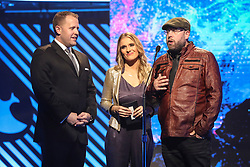 October 16, 2018 - Nashville, TN, U.S. - NASHVILLE, TN - OCTOBER 16: The Erwin Brothers and Rebecca St. James present an award during the 49th Annual Dove Awards on October 16, 2018, at Allen Arena in Nashville, TN. (Photo by Jamie Gilliam/Icon Sportswire) (Credit Image: © Jamie Gilliam/Icon SMI via ZUMA Press)