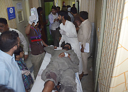 August 8, 2017 - Lahore, Punjab, Pakistan - Pakistani blast victims being treated at local hospital following an explosion on August 07, 2017 in Lahore. An explosion injured at least 34 people late August 7 in Pakistan's eastern city of Lahore, officials said, with its cause not immediately clear. (Credit Image: © Rana Sajid Hussain/Pacific Press via ZUMA Wire)