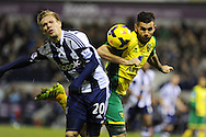 WBA's Matej Vydra (l) is challenged by Bradley Johnson of Norwich city. Barclays Premier league, West Bromwich Albion v Norwich city at the Hawthorns in West Bromwich, England on Sat 7th Dec 2013. pic by Andrew Orchard, Andrew Orchard sports photography.